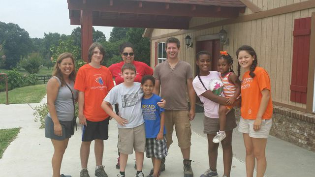 RAF staff, PGG volunteers Isabel and Skye, and a few of the kiddos from camp